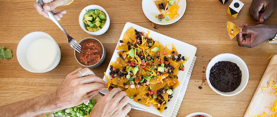 Real Plans People Sharing Nachos on a Wood Table